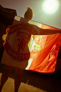 Naked woman with Manchester United Flag