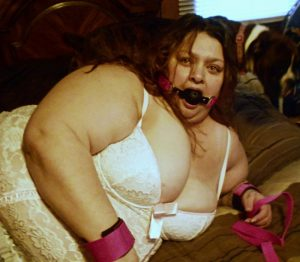 Gagged and waiting for her man