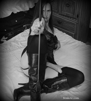 Female domme with whip
