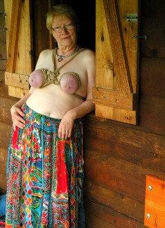 Woman in breast bondage rope