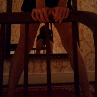 Woman bending over bed frame