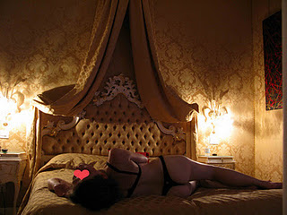 Woman in lingerie on four poster bed
