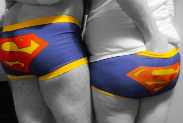 couple wearing matching superhero pants