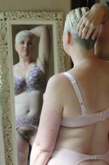 Woman in vintage lingerie with pubic hair