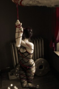 Jade tied up with red rope
