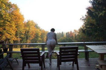 Standing naked in deck in the morning light
