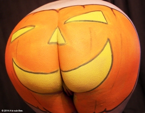 Womans bum painted as a pumpkin with body paint