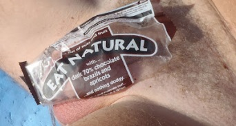 Man with fruit and nut wrapper over his dick