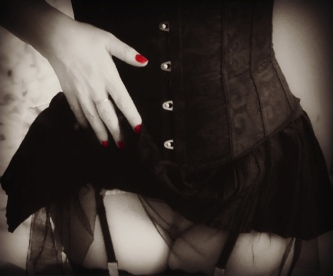 Red nails with corset, tulle skirt and peak of pussy