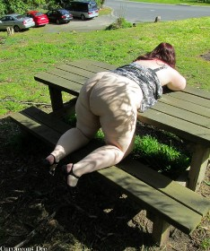 Woman bending over picnic table