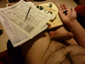 man playing roleplay dice game with hard cock