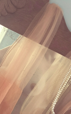 vintage stockings and pearls on mirror with nude woman