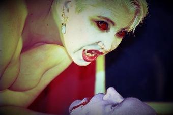 Woman vampire feasting on man