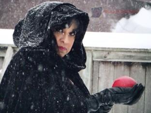 Woman in cloke in snow
