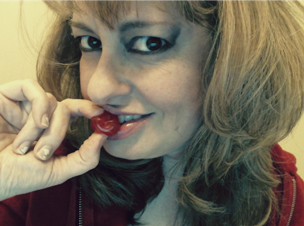 Woman nibbling on red cherry