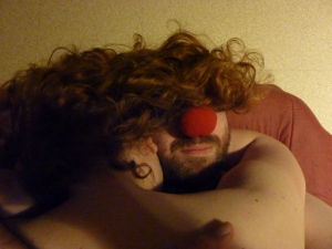 Clown hugging woman & wearing her hair