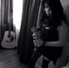 sexy woman with guitar and whisky