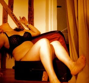 Woman in underwear in suitcase