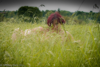 Molly in field of long grass