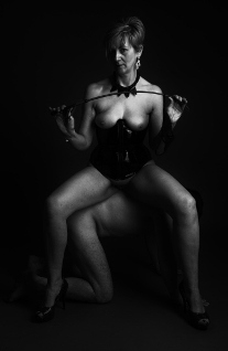 Female dom sitting on the back of male sub