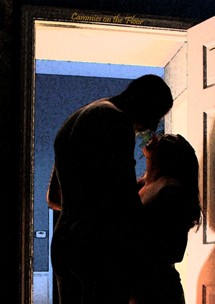 Man and woman silhouette kissing