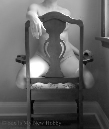 Naked woman on chair