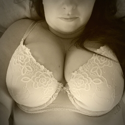 Large breasted woman in pretty bra