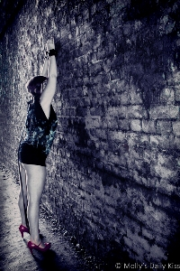 Molly up against a brick wall