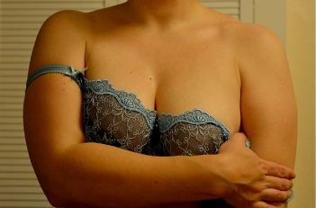 Woman taking of pretty bra