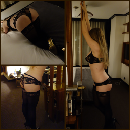 Woman in black sexy lingerie tied to bed post