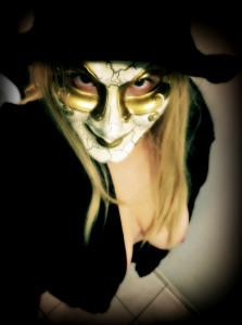 Woman topless wearing halloween mask