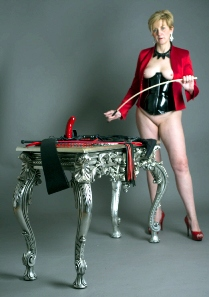 Female Domme with a table full of evil things