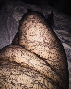 Woman in lace body stocking