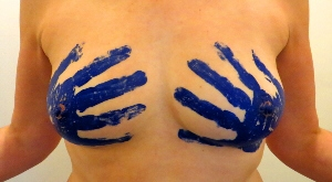 Blue hand prints on womans breasts