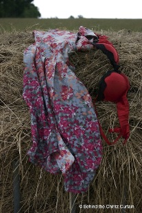 Discarded clothes on a haystack