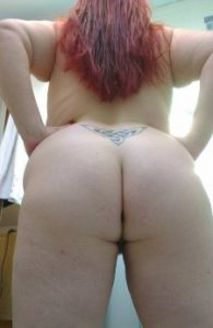 Ht honey nude from the back with long red hair for sinful sunday