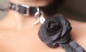 Black rose collar and leash on woman