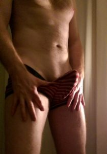 Man with erect penis inside his underwear