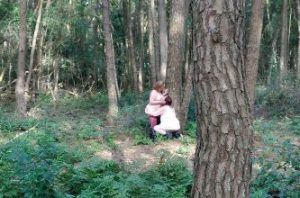 two women having sex in the woods