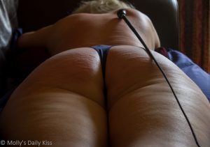 Whip marks kisses on womans bum