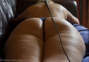 whip laying along womans back