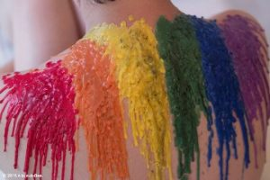 Rainbow pride wax on womans back sinful sunday