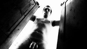 naked man looking into wardrobe