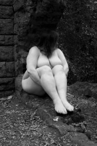 Nude of woman sitting in ruins sinful sunday