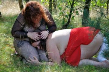 Two women in the woods cuddling