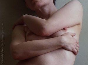 Woman hugging herself Sinful Sunday