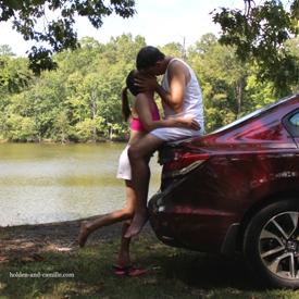 Summer lovin kissing on trunk of car