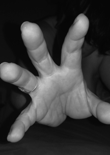 hand reaching to the camera out of the darkness