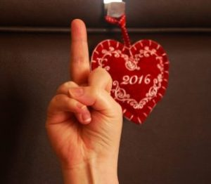 2016 sign with someone giving the finger