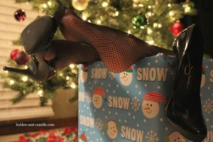 Womans feets sticking out of Christmas present box